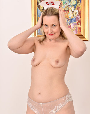 Sexy mature nurse Emma Turner