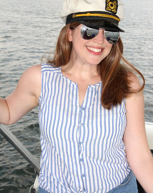 Busty captain Holly Fuller on the boat