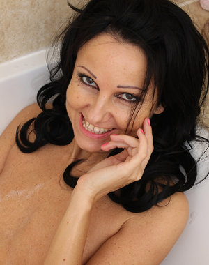 Lovely mature Julie D gets all wet and soapy for you as she luxuriates and plays in the bathtub
