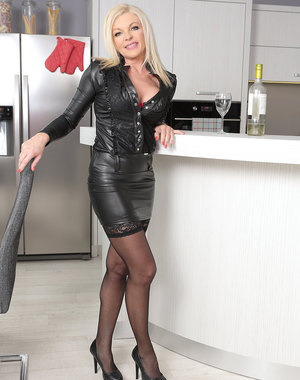 Blonde MILF Carolina Carla enjoys a glass of wine before slipping out of her tight leather
