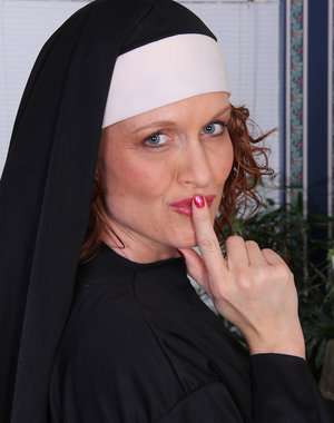 Sexy nun Roxanne Clemmens has a great habit of stripping and masturbating