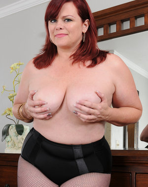 Curvy mature Marcy Diamond shows those big soft titties as she gets naked