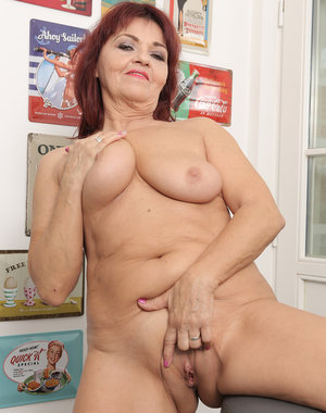 Mature honey Natalia Muray collects vintage signs and loves to tease