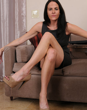 Thin brunette MILF Maggie K does some work typing and gets nude on the couch