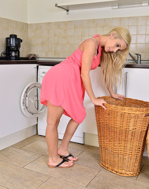 Stunning blonde Nesty does some laundry and flashes her perfect form