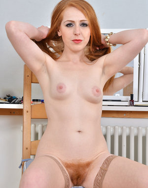Sexy redhead Tia Jones spreads to show her hairy pussy as she readies for bed