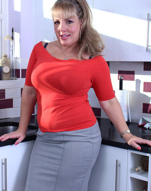 Curvy cutie Danielle T gets naked in the kitchen showing off her big tits