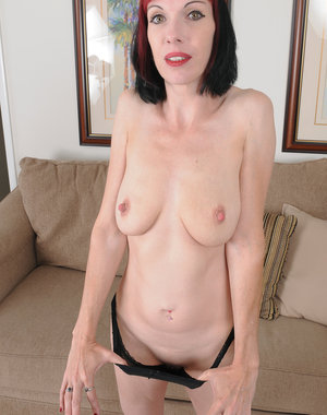 Goth hottie Alyce Porter has a little foot fetish fun and gets naked