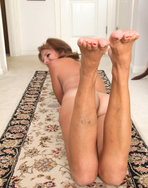 Cute little 49 year old Nicole Newby spreads her legs and pussy wide