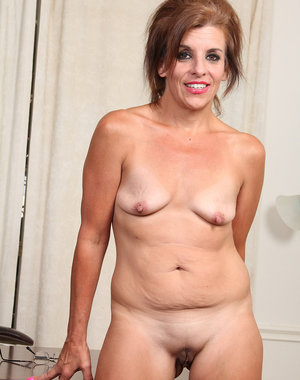 Spicey 49 year old Nicole Newby spreads her box wide at the office