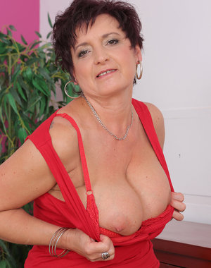 Beautiful 52 year old Jessica Wild gets naked after doing housework