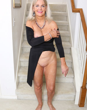 Beautiful 58 year old Judy Mayflower playing with her tits on the stairs