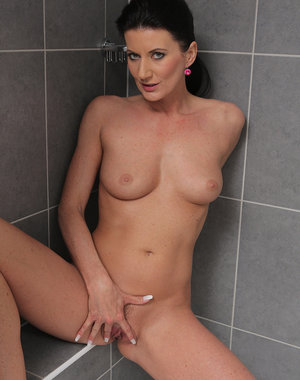 32 year old brunette Olivia gets herself hot and wet in the shower