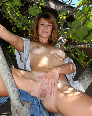 Hot 30 year old Sophia K plays naked with a chansaw in the yard