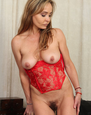 Cute  44 year old Kelsey Majors in red lace showing off furry snatch