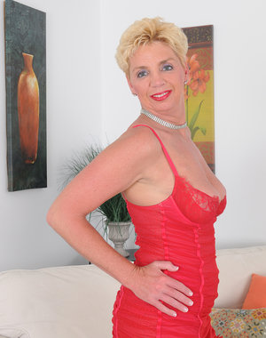 Blonde 47 year old Taylor Lynn in red lingerie spreading her long legs
