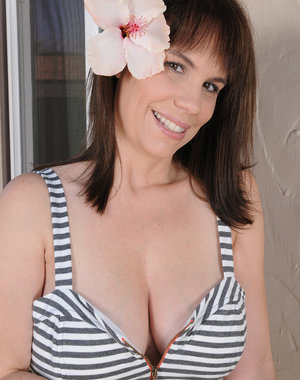 Horny 41 year old Kelly Capone lets her big funbags hang freely