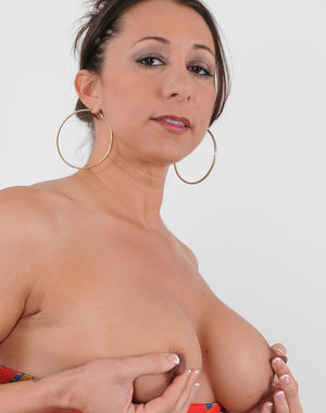 Beautiful 36 year old Kaylynn slips out of her elegant dress to pose