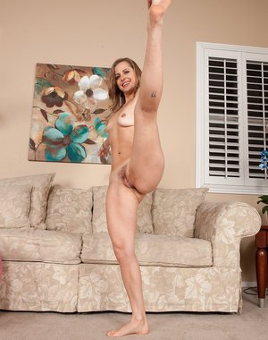 Athetic blonde Melissa Rose works her nude body on the pallati ball