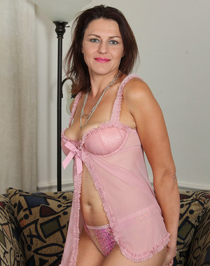 41 year old and cute Joana Jakes slides out of her pink lingerie here