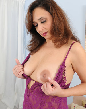 Decked out in purple lingerie Alesia Pleasure does a great strip tease