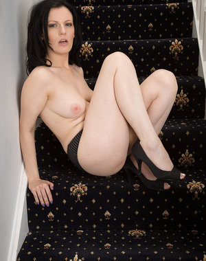 Pale and horny Charisma Jones from AllOver30 spreading on the stairs