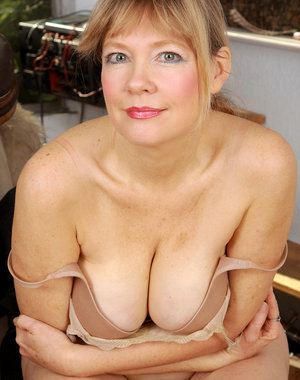 Beautiful 53 year old Lilli slowly strips off her suit and spreads her box