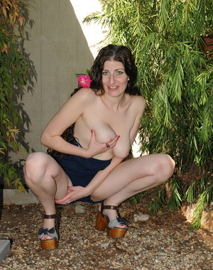 34 year old brunette MILF Sabrina Deep enjoying the great outdoors