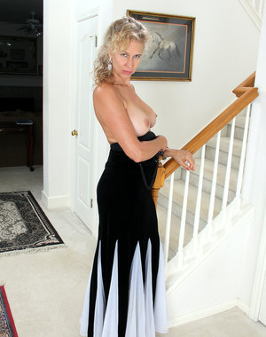 54 year old Sabrina from AllOver30 slides out of her elegant dress