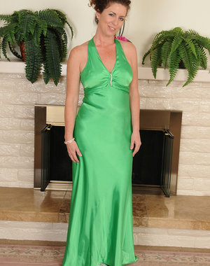 Elegant 46 year old Tammy Sue slips out of her green evening gown