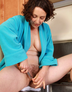 39 year old brunette Artemesia trims her airy pussy in the kitchen