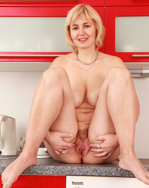 Hot blonde Stella spreads her 43 year old beaver on the counter