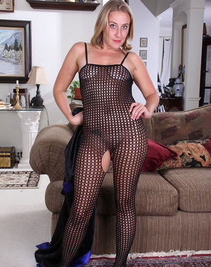 Horny blonde MILF Chance posing sexy in her black fishnet body suit