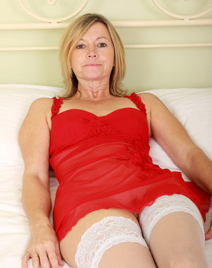 Sexy 48 year old Susie slams a large plastic dildo into her mature hole
