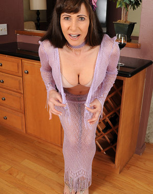 Elegant 47 year old Alexandra Silk spreading her long firm legs