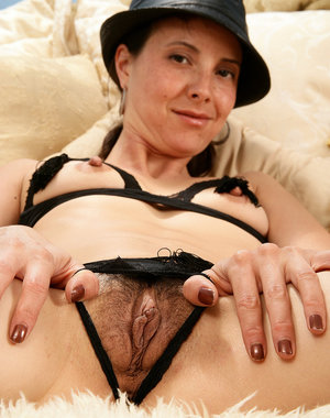 Skinny 34 year old Lily wearing kinky black lingerie and a fedora