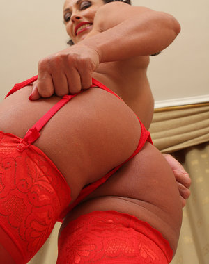 Sexy 36 year old Sandy K slips out of her hot red lingerie in here