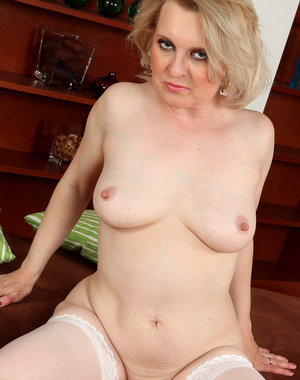 43 year old blonde Margeaux strips off her sexy white lingerie