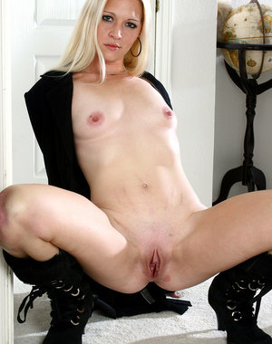 Long haired blonde Kyra spreads her long legs to reveal her shaven pussy