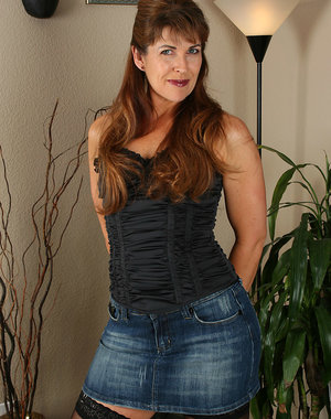 Andie shows off her denim skirt before showing off her hairy pussy