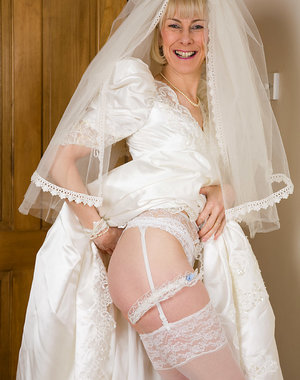 52 year old Hazel pulls off her wedding dress and spreads her ass