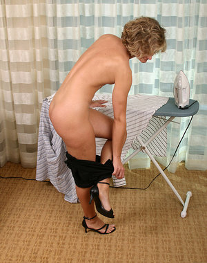 Small tittied housewife doing chores in the buff
