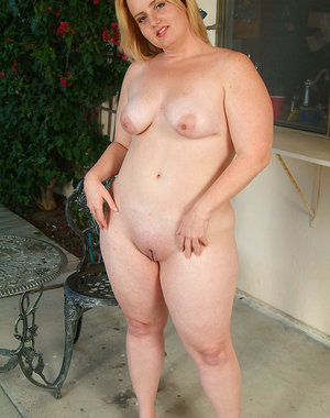 34 year old Solsa getting naked in the backyard